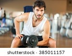 man training in a gym | Shutterstock . vector #385011157