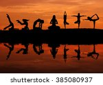 silhouette of a beautiful yoga... | Shutterstock . vector #385080937