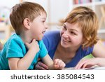 little kid and his mother are... | Shutterstock . vector #385084543