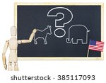 Small photo of Agitator encourages to vote on elections in the US. Abstract image with a wooden puppet