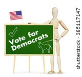 Small photo of Agitator encourages vote for Democrats in US elections. Abstract image with a wooden puppet