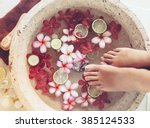 foot bath in bowl with lime and ... | Shutterstock . vector #385124533