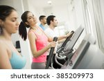 young people training in the gym | Shutterstock . vector #385209973