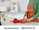 young woman cooking in the... | Shutterstock . vector #385225573