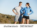 young couple on beach training... | Shutterstock . vector #385365667
