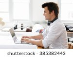 young businessman in office | Shutterstock . vector #385382443