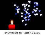 many burning candles with... | Shutterstock . vector #385421107