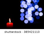 many burning candles with... | Shutterstock . vector #385421113