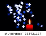 many burning candles with... | Shutterstock . vector #385421137