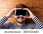 man wearing virtual reality... | Shutterstock . vector #385433683