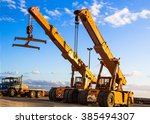 auto cranes on construction site | Shutterstock . vector #385494307