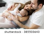 happy family with newborn baby | Shutterstock . vector #385503643
