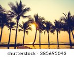 silhouette palm tree on the... | Shutterstock . vector #385695043