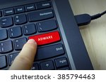 Small photo of Close up of finger on keyboard button with ADWARE word