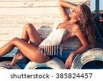 tanned young woman in bikini... | Shutterstock . vector #385824457