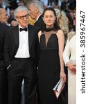 """Small photo of CANNES, FRANCE - MAY 15, 2015: Director Woody Allen & wife Soon-Yi at the gala premiere for his movie """"Irrational Man"""" at the 68th Festival de Cannes."""