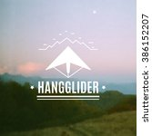 silhouette of a hangglider with ... | Shutterstock .eps vector #386152207
