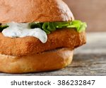 fresh and fried fish burger... | Shutterstock . vector #386232847