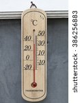 Small photo of Closeup photo of household alcohol thermometer showing temperature in degrees Celsius