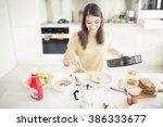 runny fried eggs for breakfast... | Shutterstock . vector #386333677