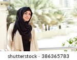 smiling girl in hijab covering... | Shutterstock . vector #386365783