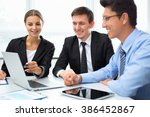 business people working with... | Shutterstock . vector #386452867