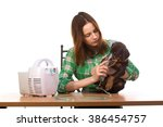 young woman using nebulizer... | Shutterstock . vector #386454757