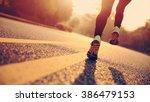 young fitness woman runner...   Shutterstock . vector #386479153
