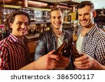 three young men in casual... | Shutterstock . vector #386500117