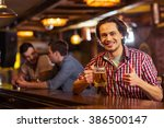 young dark haired man in casual ... | Shutterstock . vector #386500147