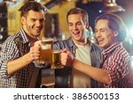 three young men in casual... | Shutterstock . vector #386500153