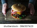 big burger with beef and cheese | Shutterstock . vector #386507623