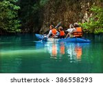 family kayaking and makes... | Shutterstock . vector #386558293