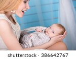 portrait of a mother with her 2 ... | Shutterstock . vector #386642767