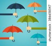 hand of man holding an umbrella.... | Shutterstock .eps vector #386658547