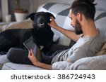dog owner petting and... | Shutterstock . vector #386724943