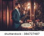 confident well dressed man...   Shutterstock . vector #386727487