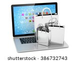 laptop and  shopping pags on... | Shutterstock . vector #386732743