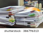 stacks of papers on the table | Shutterstock . vector #386796313