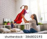 mother and her child girl... | Shutterstock . vector #386802193