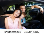 family sitting in the car... | Shutterstock . vector #386844307