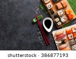 set of sushi and maki on stone... | Shutterstock . vector #386877193