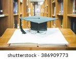 graduation cap with glasses on... | Shutterstock . vector #386909773