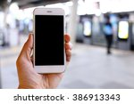 hand holding smartphone with... | Shutterstock . vector #386913343