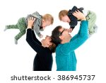 Small photo of Happy family with twins is laughing. Mother and father are holding newly adopted children above their heads in celebration of successful adoption. Isolated on white.