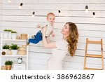 portrait of happy mother with... | Shutterstock . vector #386962867