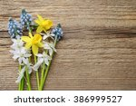Springtime Flowers On Wooden...