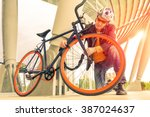 business man locking bicycle... | Shutterstock . vector #387024637