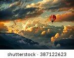 hot air balloon in a storm cloud | Shutterstock . vector #387122623