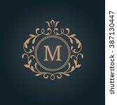 elegant floral monogram design... | Shutterstock .eps vector #387130447